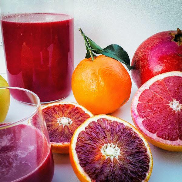 Estratto arance rosse melagrana e pompelmo rosa